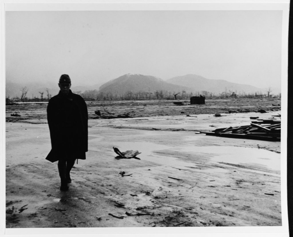 A Japanese soldier walks through the atomic-bomb leveled city, September 1945. Photographed by Lieutenant Wayne Miller, USNR. (Photo # 80-G-473733)