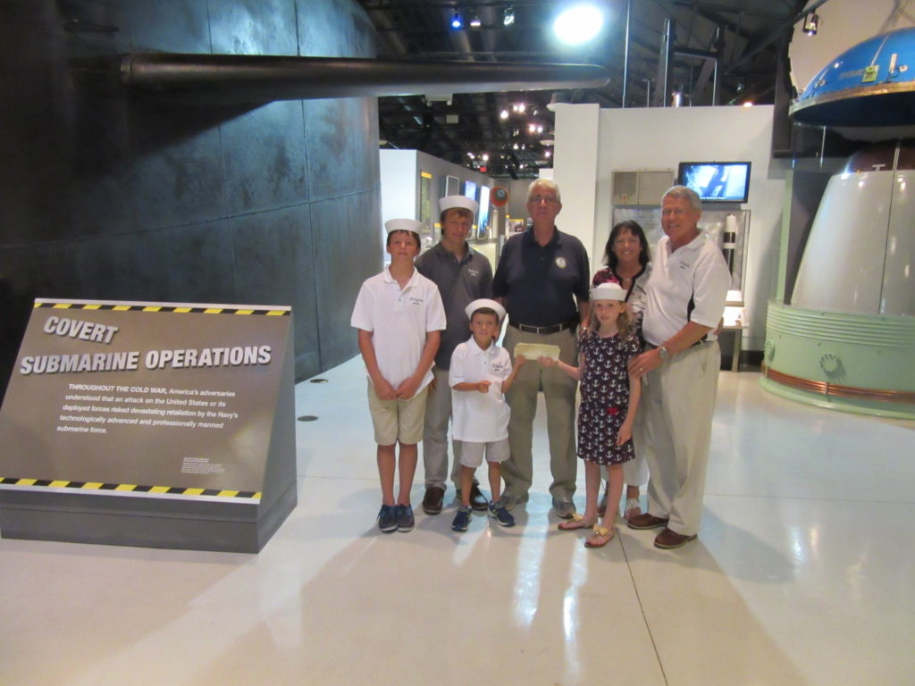 NHF Executive Director poses with the Wallace family during their recent visit to the Washington Navy Yard. (NHF Photo)