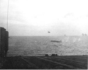 Japanese Betty bomber about to impact the water. (Showing damage to vertical stabilizer from Independence AA fire)