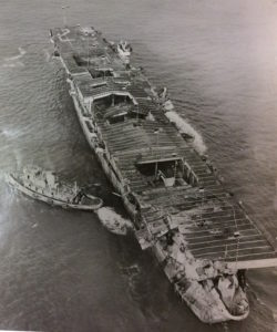 USS Independence being made ready by two tugs to be towed out and scuttled. (Photo from: John G. Lambert supplied courtesy of the US National Park Service, San Francisco CA)