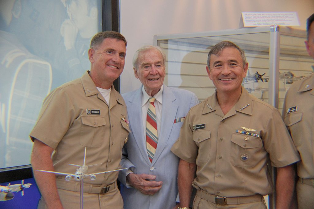 Admiral Harry Harris, PACOM, Admiral Bill Moran, VCNO (both Maritime Patrol Aviators), and model project coordinator Captain Ted Bronson, USN (Ret.) stand before the newly placed P-8A Poseidon Model (NHF Photo/Matthew Eng/Released)