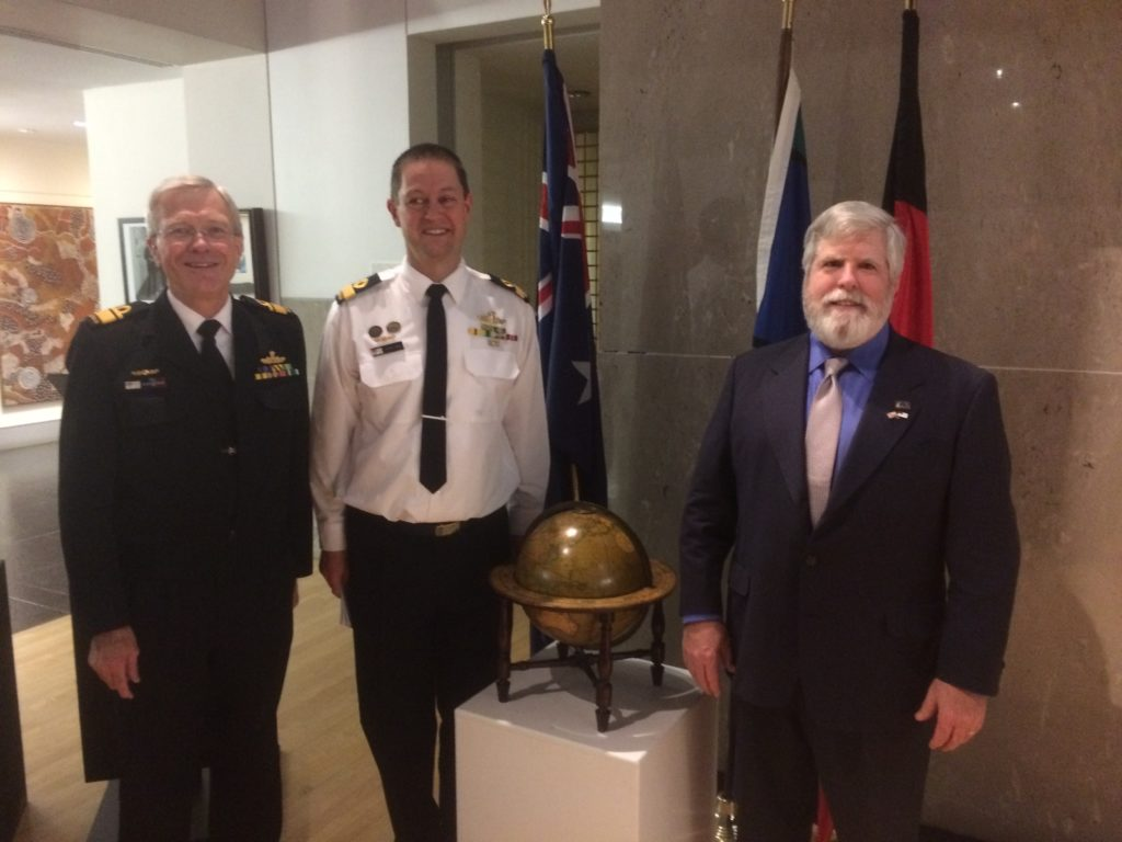 Australian Naval Attaché Commodore Peter Leavy helped NHF coordinate this special ceremony and donation. Pictured with the globe is Bollinger (right) with Leavy (middle) and RADM Steve Gilmore, Defense Attaché (left). (NHF Photo by Charles T. Creekman)